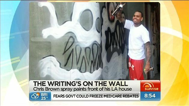 Chris Brown spraypaints his house