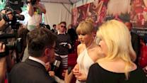 Taylor Swift Wows in a Bridal-Style White Gown