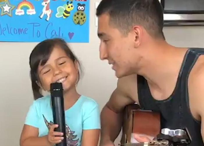 This little girl loves singing with her dad