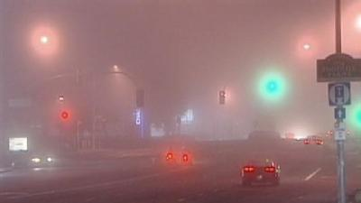 Heavy Fog Lowers Over Valley At Nightfall