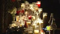 Mourners hold second vigil for shooting victims