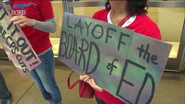Protesters rally against CPS layoffs, budget cuts