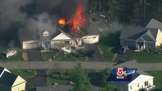 Video shows home explosion near officer-involved shooting scene