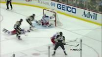 Kris Letang's pass goes off Girardi and in