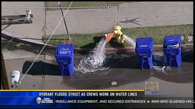Hydrant floods street as crews work on water lines
