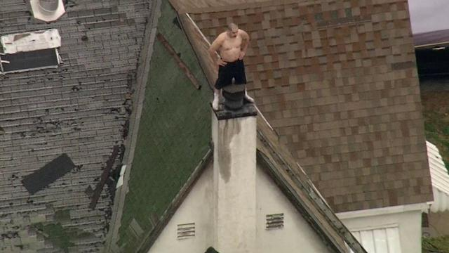 Shirtless suspect on East LA roof refuses to come down