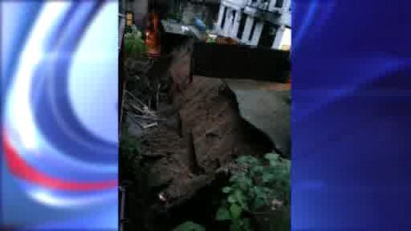 More than 100 displaced when retaining wall collapses