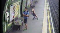 Terrifying moment child in a buggy is blown on to tracks