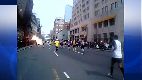 Jogger captures Boston bombing explosion