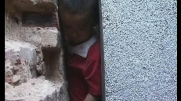 Chinese child trapped between two walls