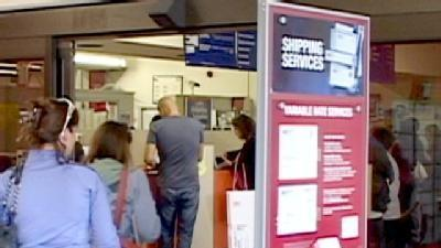 Tax Payers Swarp Post Office On Final Day