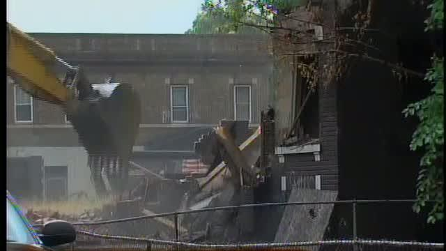 Demolition crews tear down Detroit buildings