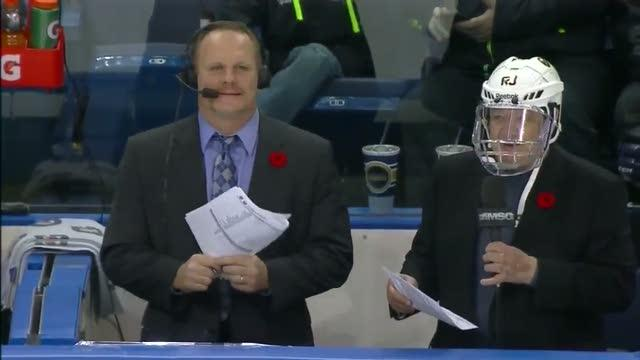 Sabres TV announcer protecting his head