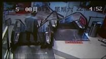 Cleaner gets foot stuck in escalator