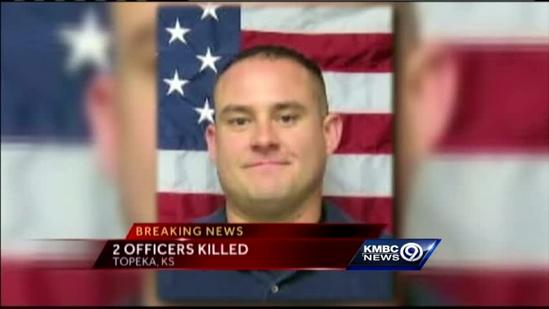 Standoff ends in connection with slayings of police officers