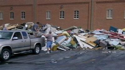 Residents Pile Up Trash From Flood