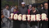 7/7 survivor and religious leaders walk in remembrance