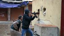 Militias battle anew in Lebanon's Tripoli, army arrests 21 fighters