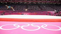 Gymnasts compete on pink floor at the Olympics