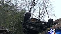 Driver walks away from bizarre crash onto roof