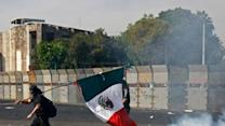 Raw: Inauguration in Mexico sparks violence