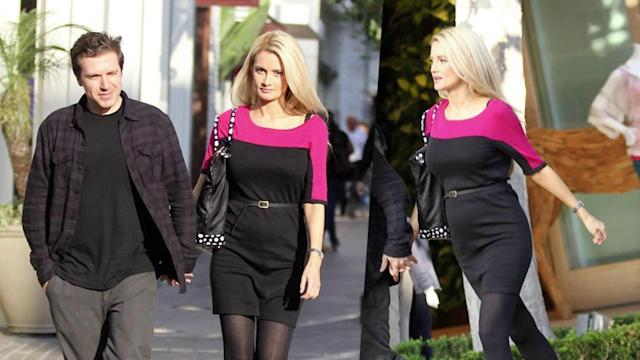 Pregnant Holly Madison Shows Off Her Growing Baby Bump in Belted Dress