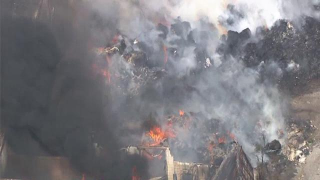 Crews battle large fire in Highland Park