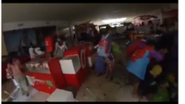 Looters raid Robinsons mall in Tacloban after typhoon Haiyan