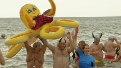 Raw: New Yorkers Take Icy New Year's Dip