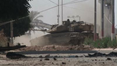 Raw: Tanks Patrol Gaza Streets During Ceasefire