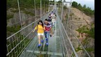Scary glass bridge opens in China
