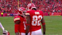 Kansas City Chiefs quarterback Alex Smith sets up wide receiver Dwayne Bowe to go for 37 yards