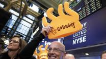 GoDaddy pops, dollar dominance and auto sales are out