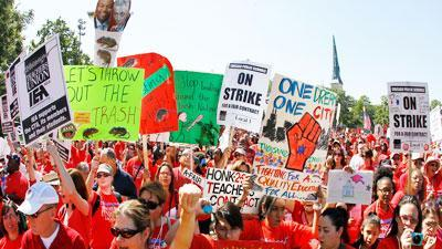 Thousands of striking teachers rally in Chicago