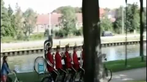 Six Man Band On a Tandem Bike