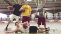 Basketball players make trick shots for video