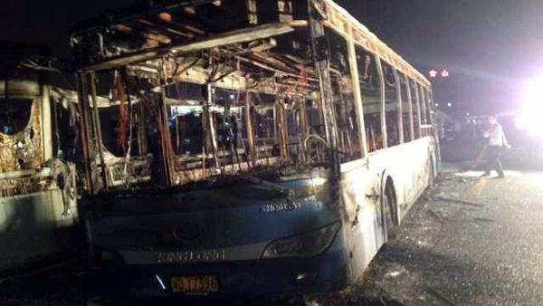 China IDs suspect, says he set bus fire in anger