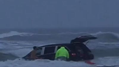 Raw: Family Rescued From Van Submerged in Ocean