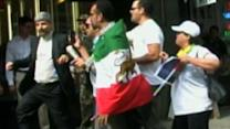 Crowd Confronts Iranian Diplomat