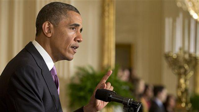 Obama focuses on health care benefits for women