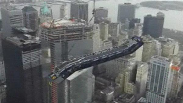 Elevator hoisted to top of World Trade Center