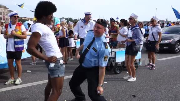 Swedish policeman dancing at gay pride