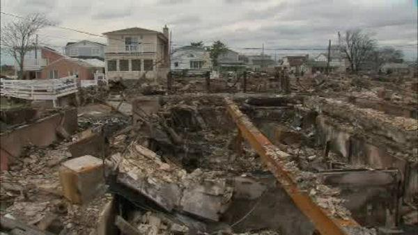 Homes ravaged by flooding and fires in Breezy Point