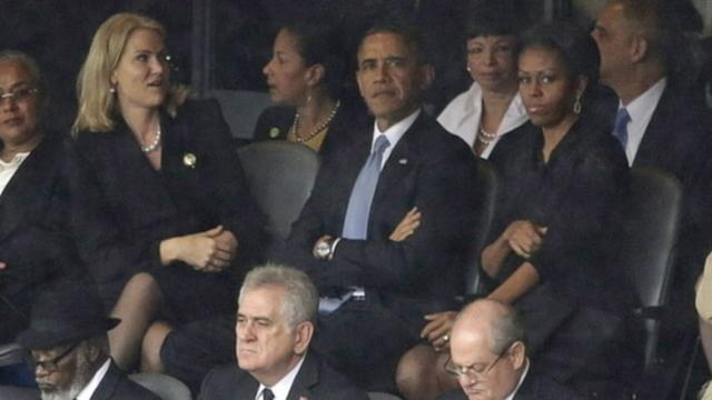 First Lady's South Africa 'Frowning' Photos Spark Buzz