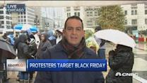 Chicago protesters target Black Friday over fatal shootin...