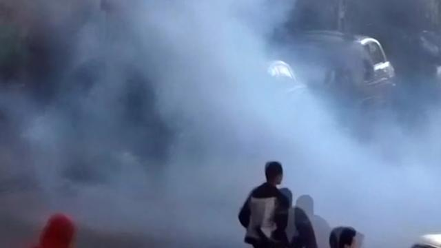 Police use tear gas to break up pro-Mursi rally in Alexandria