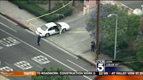 Manhunt Continues After Detectives Ambushed in Mid-City