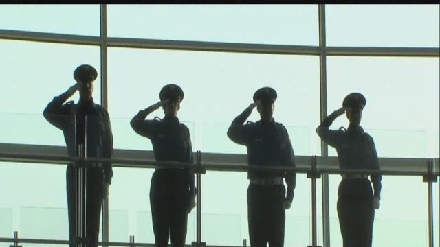 Airport staff, travelers observe moment of silence