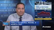Tesla shares charge on bullish guidance