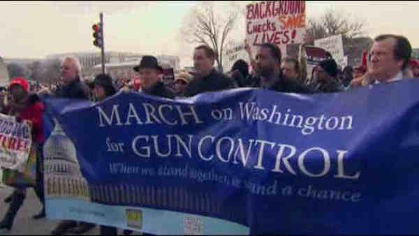 Thousands march in Washington for tighter gun control laws